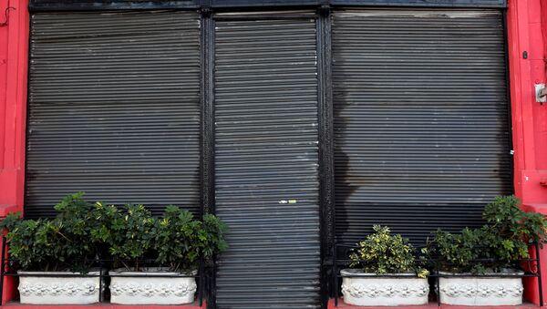 Una tienda cerrada en Buenos Aires, Argentina - Sputnik Mundo