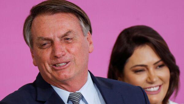 Jair Bolsonaro, presidente de Brasil, y Michelle Bolsonaro, su esposa - Sputnik Mundo