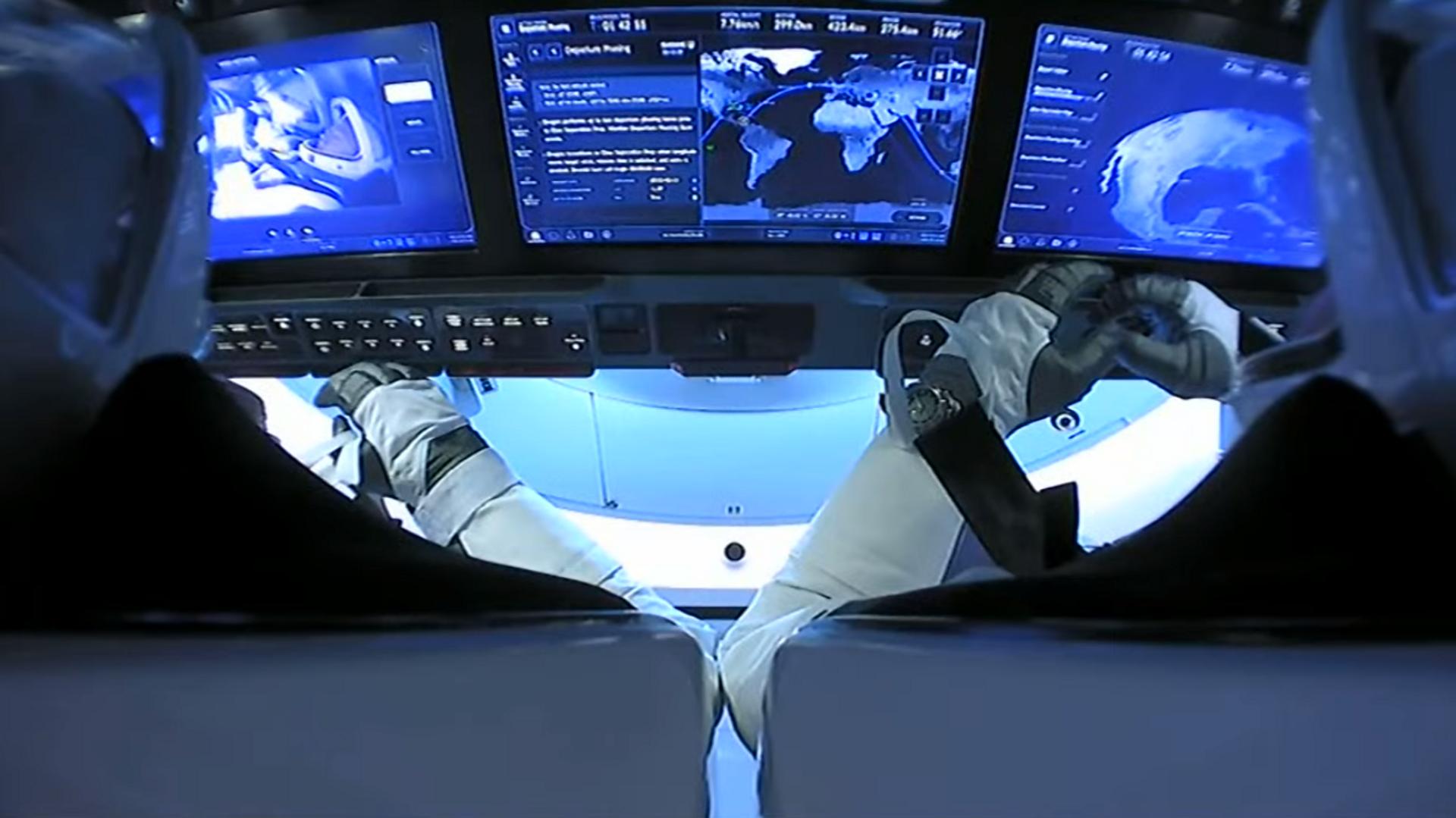 El interior de la nave tripulada Crew Dragon de SpaceX, durante su viaje de vuelta a la Tierra  - Sputnik Mundo, 1920, 30.03.2021