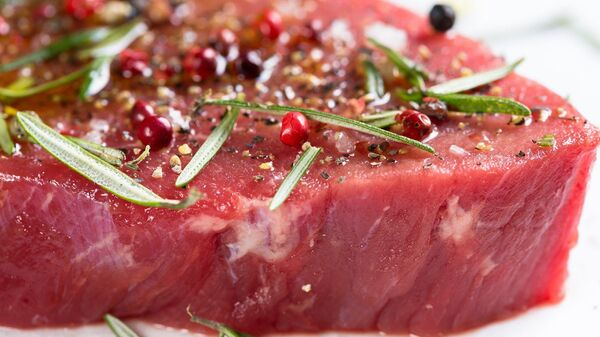 Carne cruda, imagen referencial - Sputnik Mundo