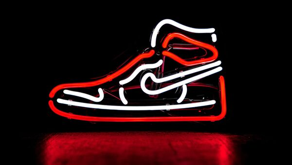 Un zapato de Nike (imagen referencial) - Sputnik Mundo