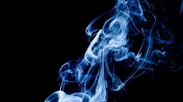 Imagen referencial de humo de tabaco - Sputnik Mundo