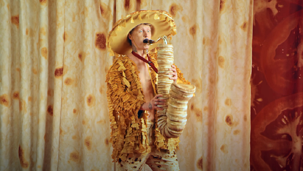 El vídeo musical 'Tacos', captura de pantalla - Sputnik Mundo