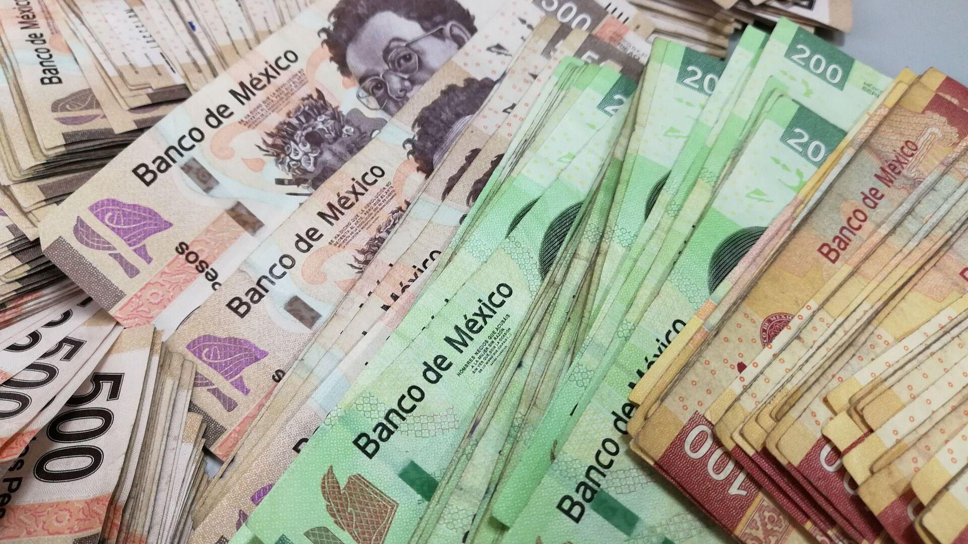 Pesos mexicanos (archivo) - Sputnik Mundo, 1920, 29.07.2021