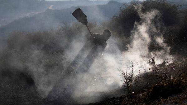 Consecuencias del lanzamiento de globos incendiarios en la Franja de Gaza - Sputnik Mundo