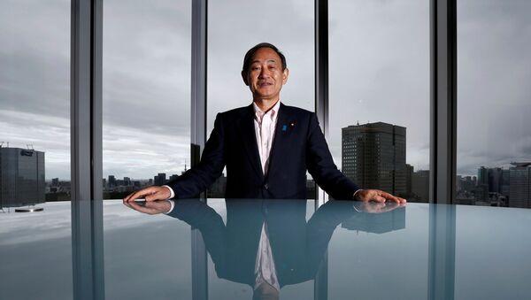 Yoshihide Suga, secretario general del Gabinete japonés - Sputnik Mundo