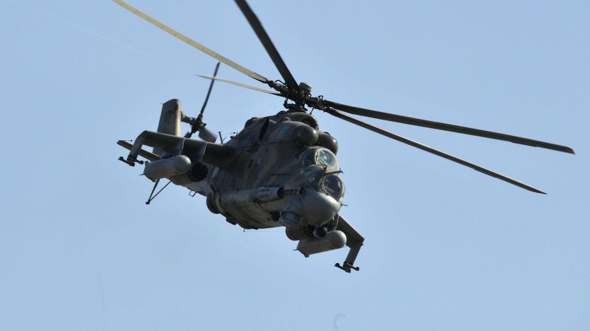 Helicóptero Mi-24 durante las maniobras Kavkaz 2020 - Sputnik Mundo, 1920, 12.02.2021