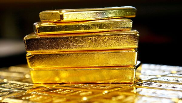 Una pila de lingotes de oro - Sputnik Mundo