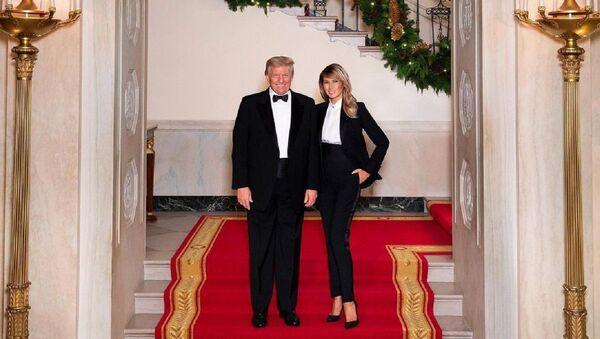 El presidente de EEUU, Donald Trump, junto a su mujer, Melania Trump - Sputnik Mundo