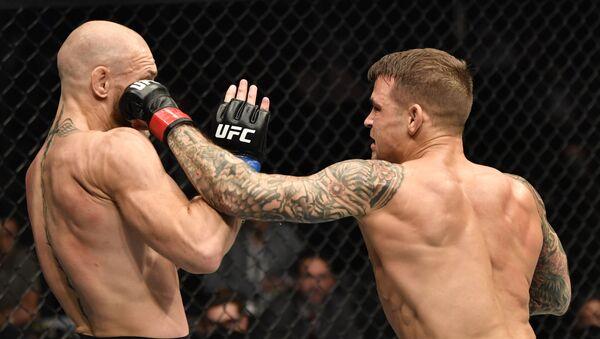 La pelea entre Conor McGregor y Dustin Poirier - Sputnik Mundo