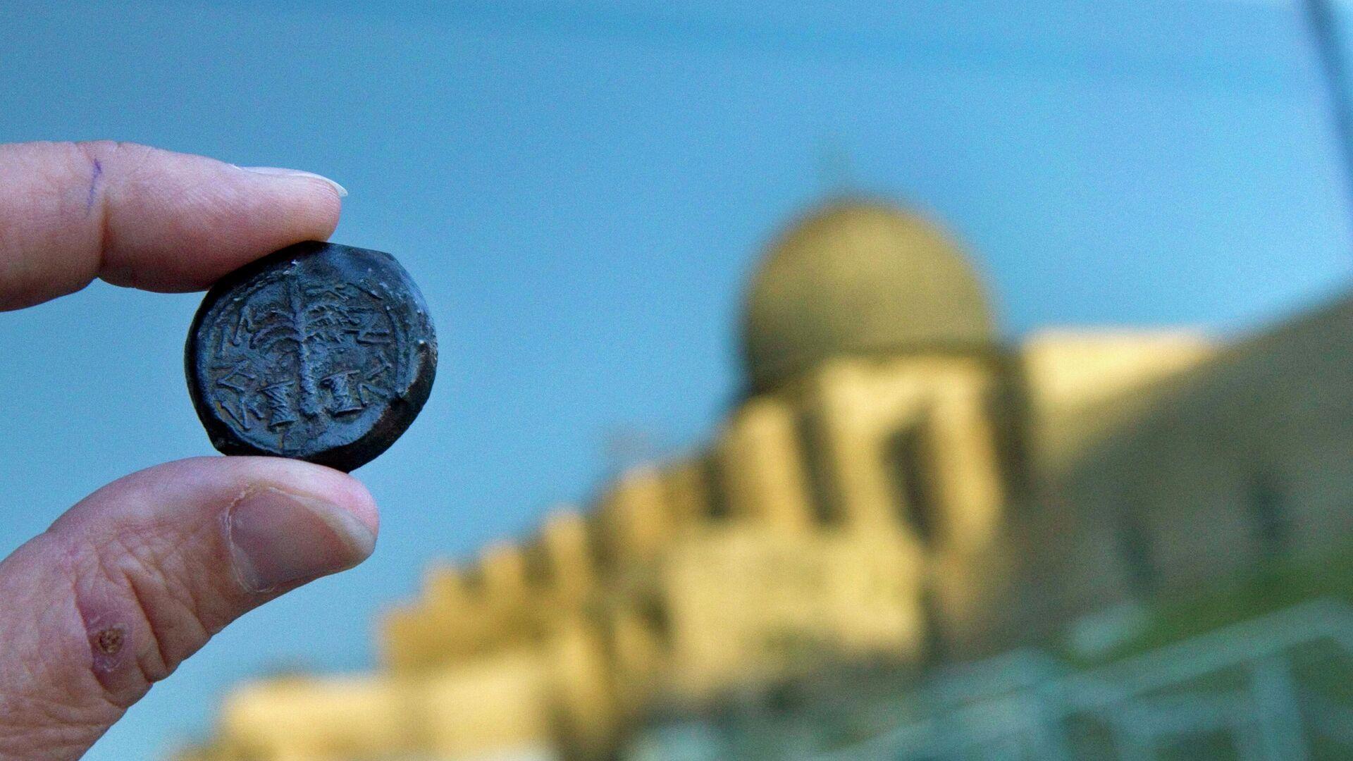 Una moneda romana y la vista de Jerusalén (archivo) - Sputnik Mundo, 1920, 12.02.2021