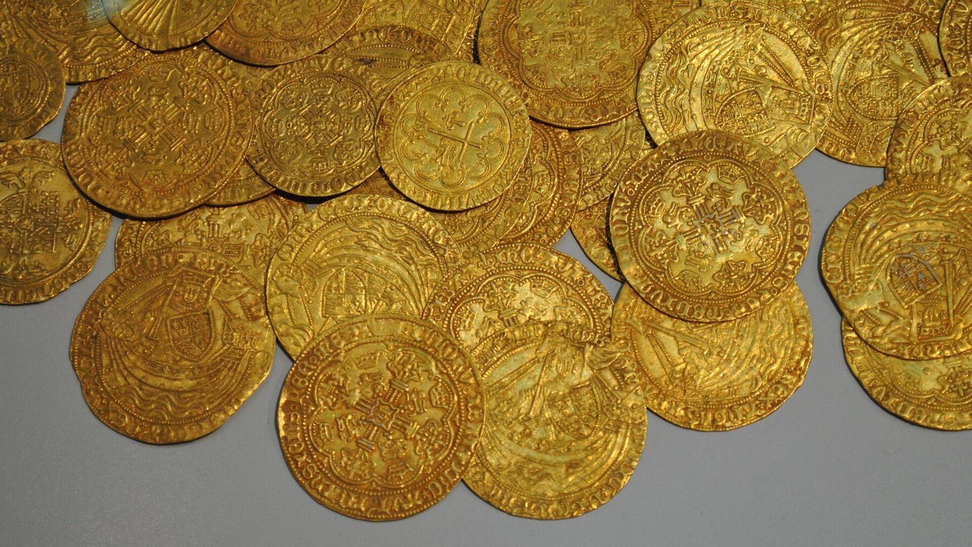 Monedas de oro. Imagen referencial - Sputnik Mundo, 1920, 02.03.2021