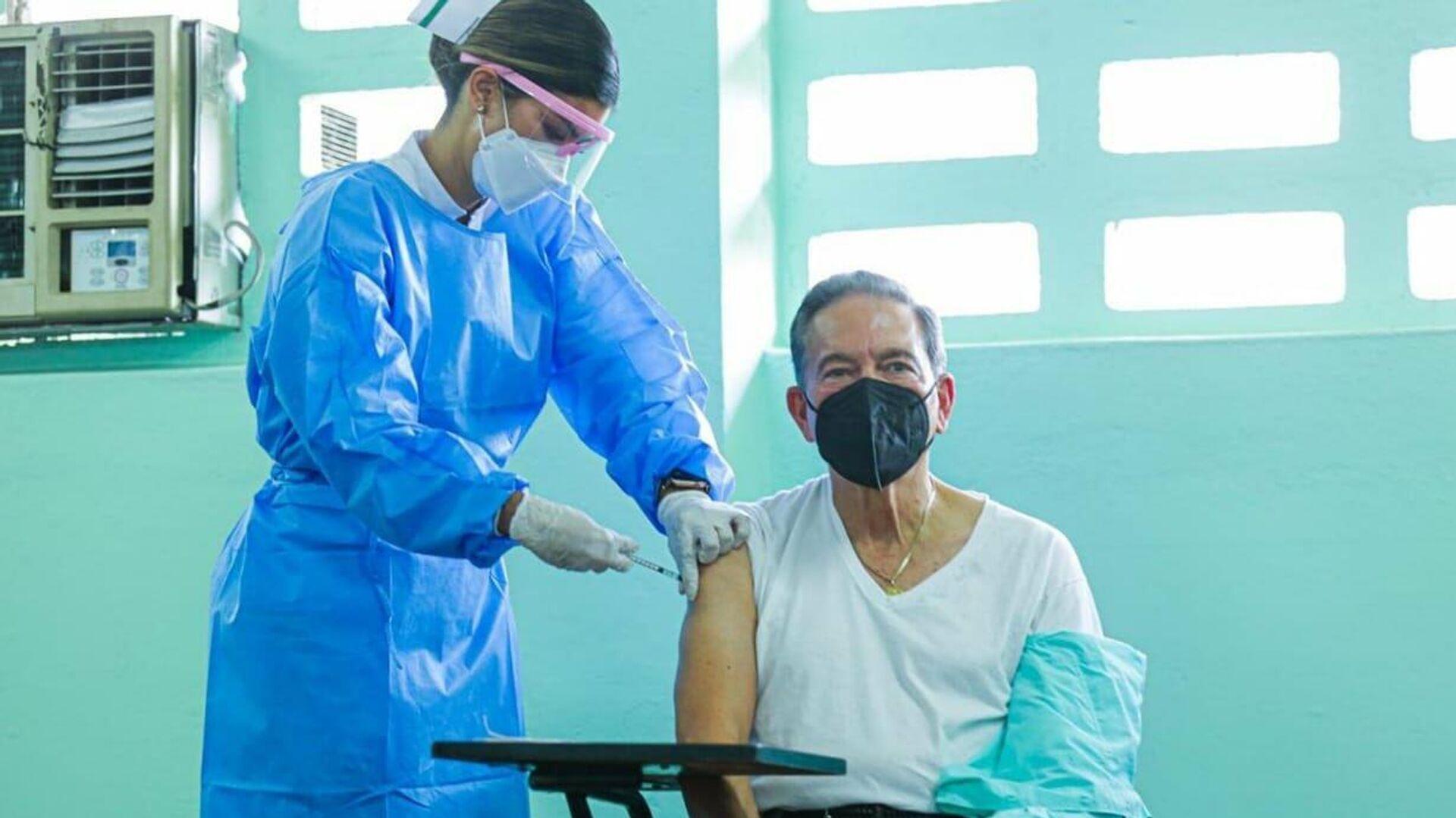 Laurentino 'Nito' Cortizo, presidente de Panamá, recibiendo la vacuna contra COVID-19 - Sputnik Mundo, 1920, 16.09.2021