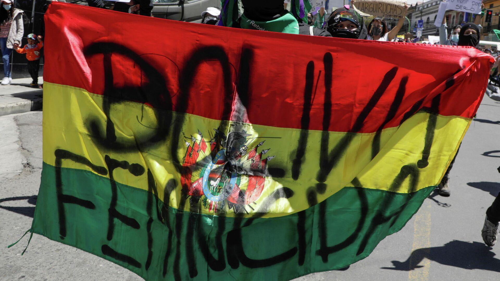 Manifestante contra los feminicidios en Bolivia durante el Día Internacional de la Mujer - Sputnik Mundo, 1920, 10.03.2021