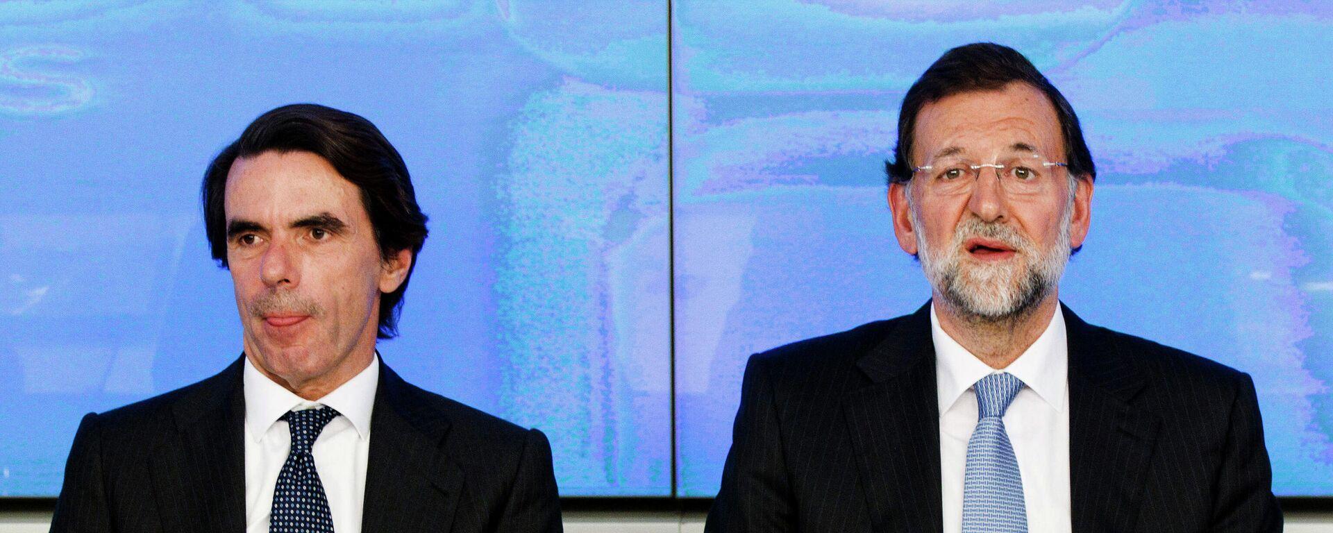 Los expresidentes del Gobierno español José María Aznar y Mariano Rajoy - Sputnik Mundo, 1920, 24.03.2021