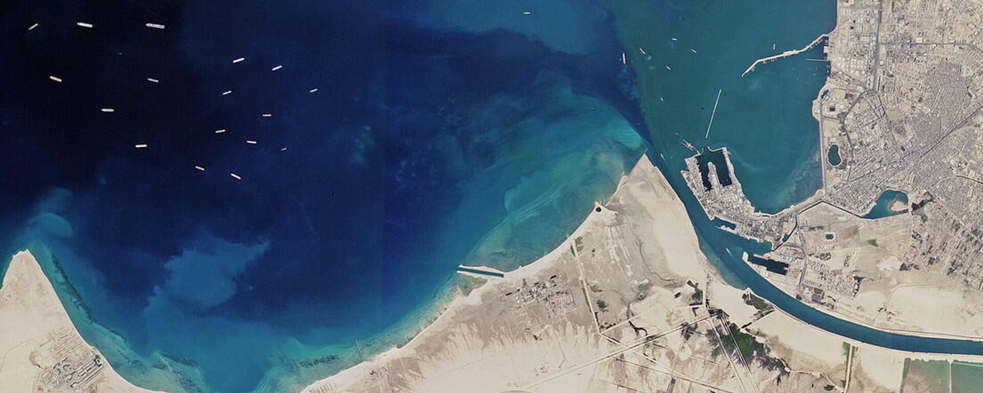 El atasco de buques alrededor del Canal de Suez visto desde el espacio - Sputnik Mundo, 1920, 26.03.2021