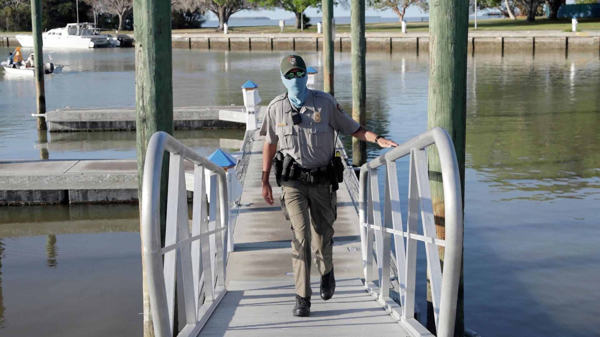 Guarda forestal en el Parque Nacional Everglades, EEUU - Sputnik Mundo, 1920, 29.03.2021