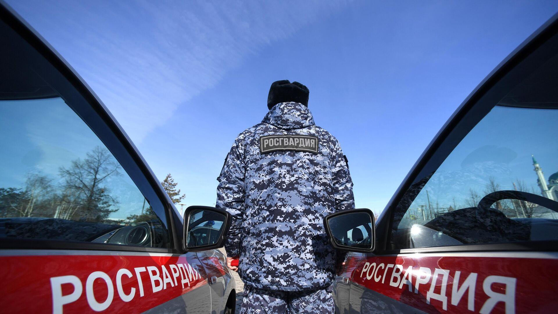 Un agente de la Guardia Nacional de Rusia (Rosgvardia) - Sputnik Mundo, 1920, 30.03.2021