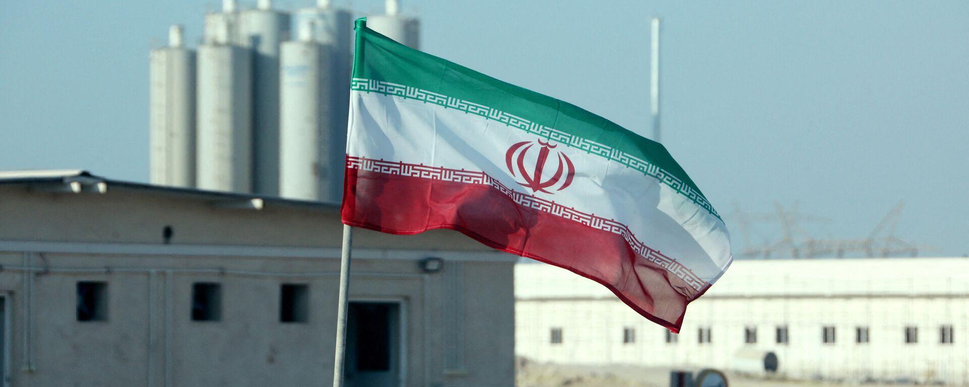 La bandera de Irán frente a una planta nuclear (archivo) - Sputnik Mundo, 1920, 10.09.2021