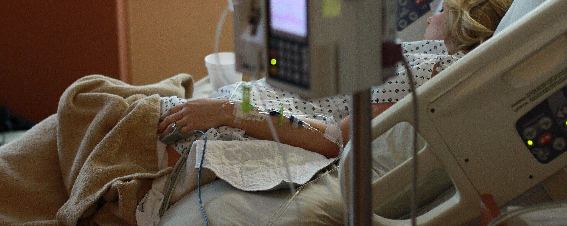 Una mujer en un hospital. Imagen referencial - Sputnik Mundo, 1920, 14.09.2021