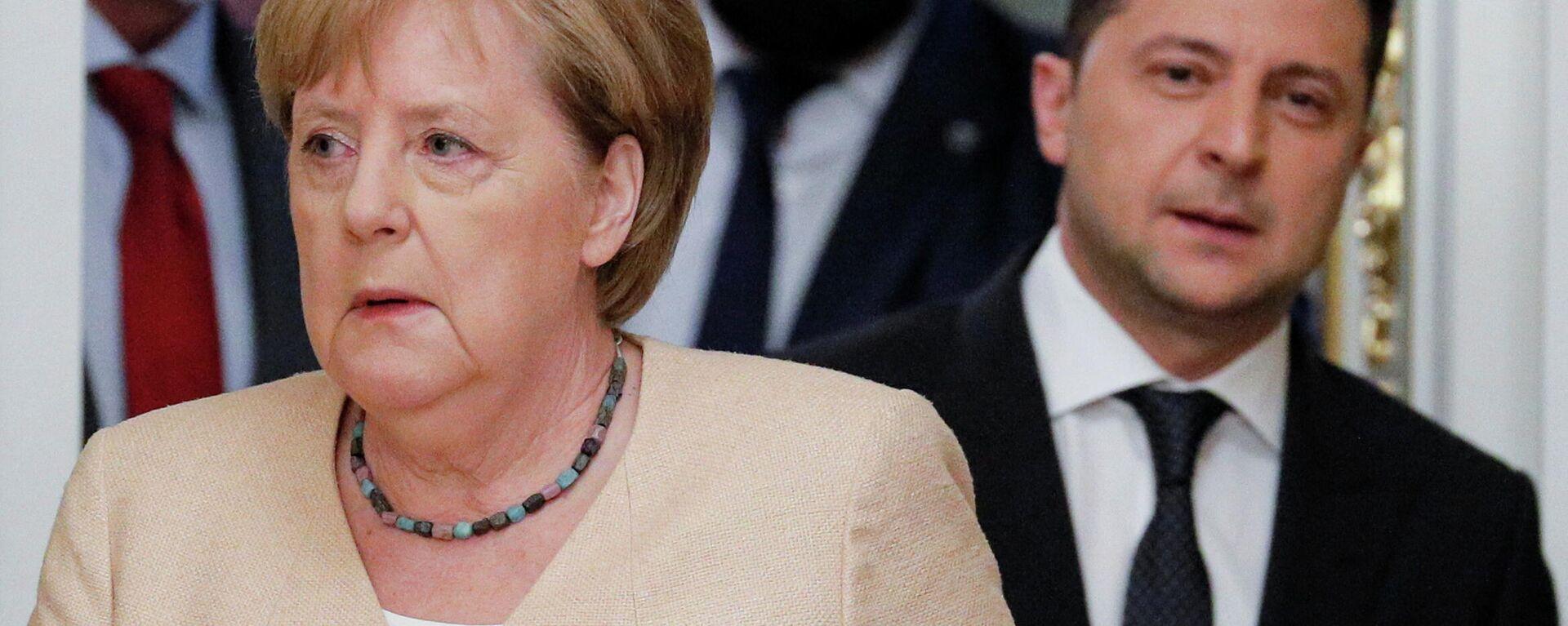 La canciller federal de Alemania, Angela Merkel, y el presidente ucraniano, Volodímir Zelenski - Sputnik Mundo, 1920, 23.08.2021