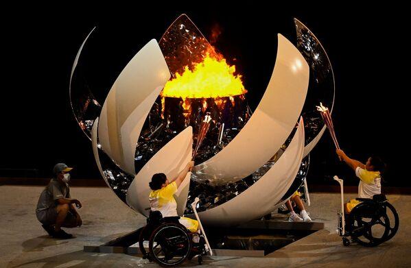 Todos tenemos alas, este es el lema de los Juegos Paralímpicos de Tokio. En la foto: el encendido de la llama paralímpica en la ceremonia de inauguración de los Juegos Paralímpicos 2020. - Sputnik Mundo