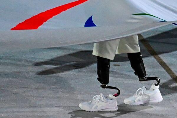La bandera paralímpica en la ceremonia de inauguración de los Juegos Paralímpicos de Tokio. - Sputnik Mundo