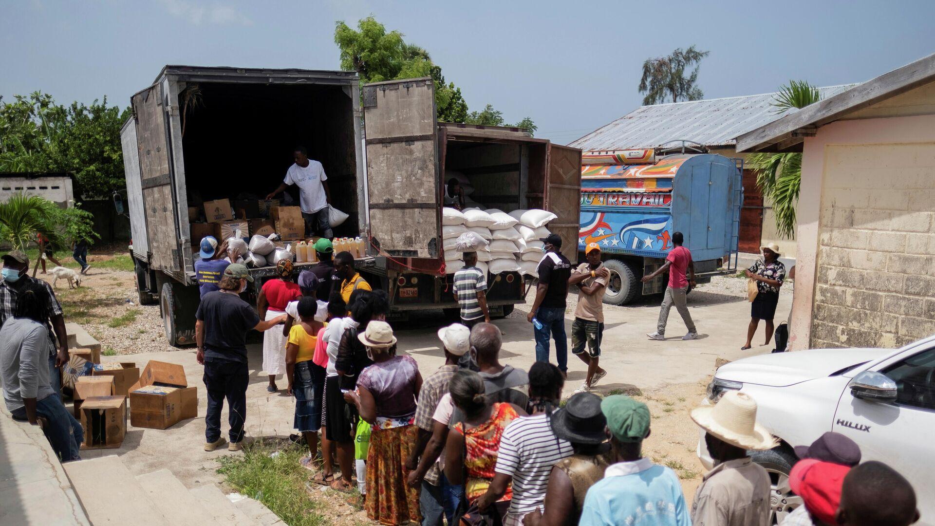 Haitianos reciben la ayuda humanitaria - Sputnik Mundo, 1920, 31.08.2021