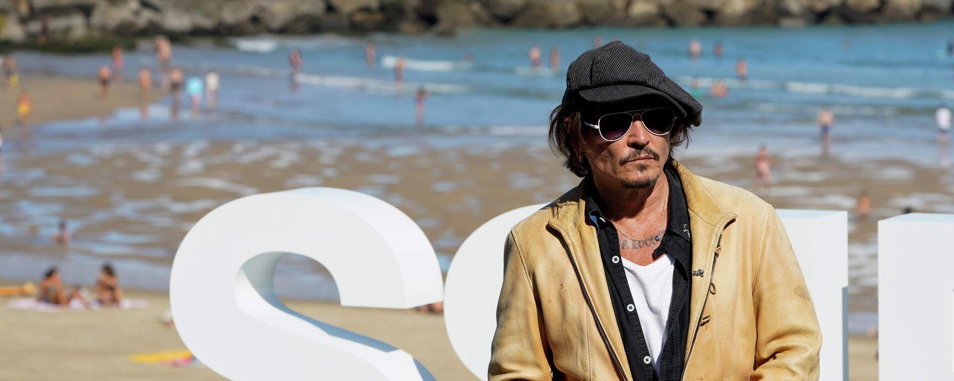 El actor y productor de cine estadounidense Johnny Depp participa en una sesión de fotos para promocionar el documental Crock Of Gold: A few rounds with Shane Macgowan, en el Festival de Cine de San Sebastián, España, el 20 de septiembre de 2020 - Sputnik Mundo, 1920, 13.09.2021