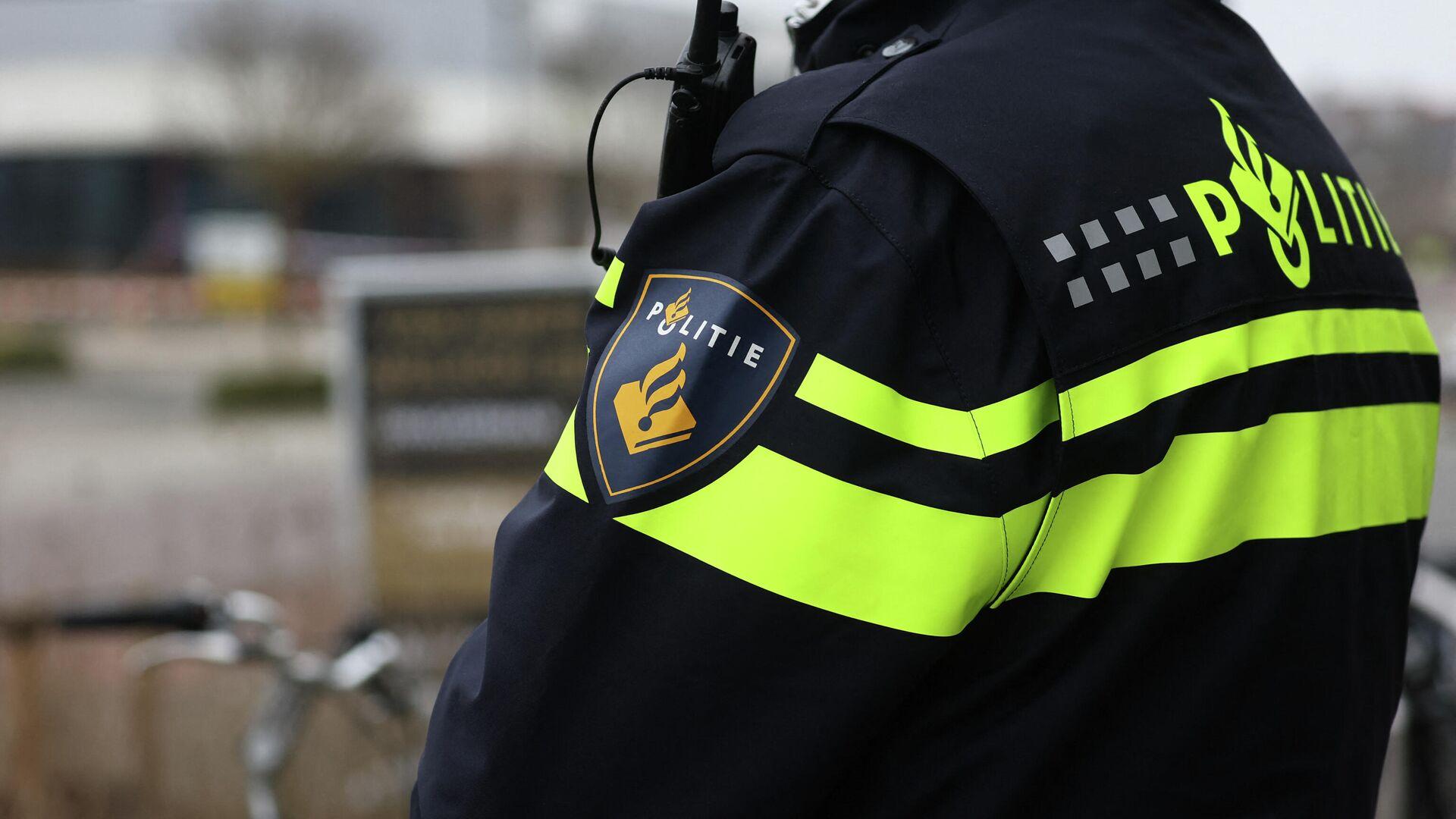Un agente de la Policía de Países Bajos (imagen referencial) - Sputnik Mundo, 1920, 17.09.2021
