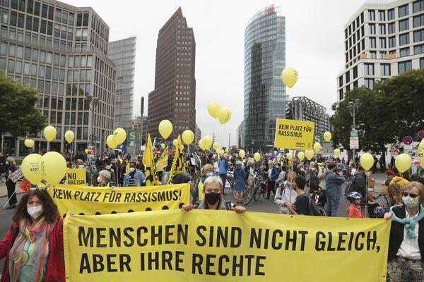 Participantes en la manifestación electoral en Berlín, Alemania. - Sputnik Mundo