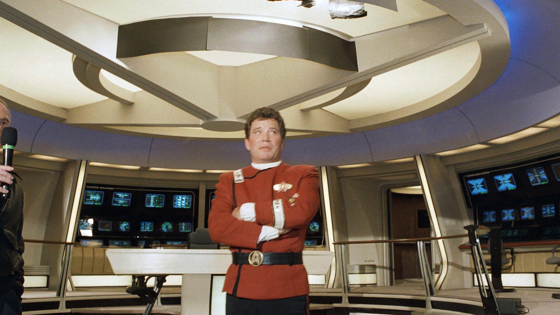 William Shatner en el papel del Capitán Kirk, personaje de la serie televisiva 'Star Trek' - Sputnik Mundo, 1920, 25.09.2021