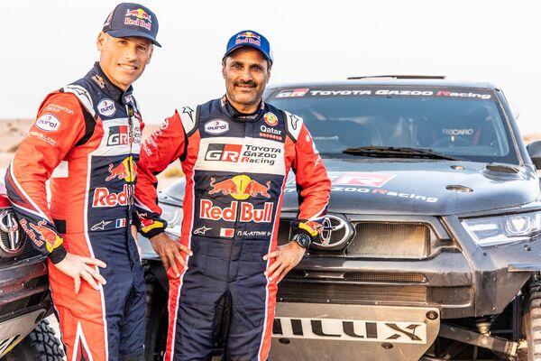 El piloto catarí Nasser Al-Attiyah y su navegador Mathieu Baumel - Sputnik Mundo