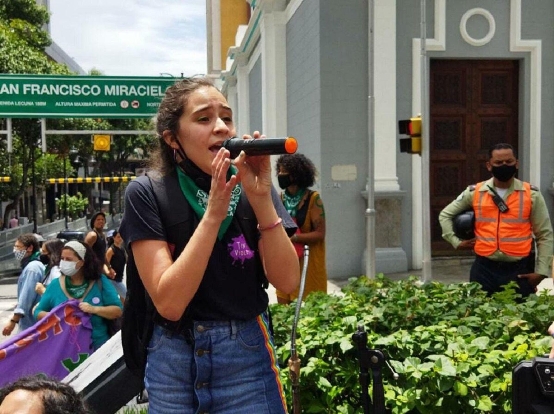 Laura Cano, integrante de la organización feminista venezolana Tinta Violeta - Sputnik Mundo, 1920, 28.09.2021