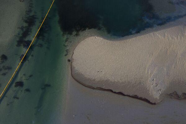 Una mancha de 34 kilómetros cuadrados cubre las aguas del Pacífico. - Sputnik Mundo