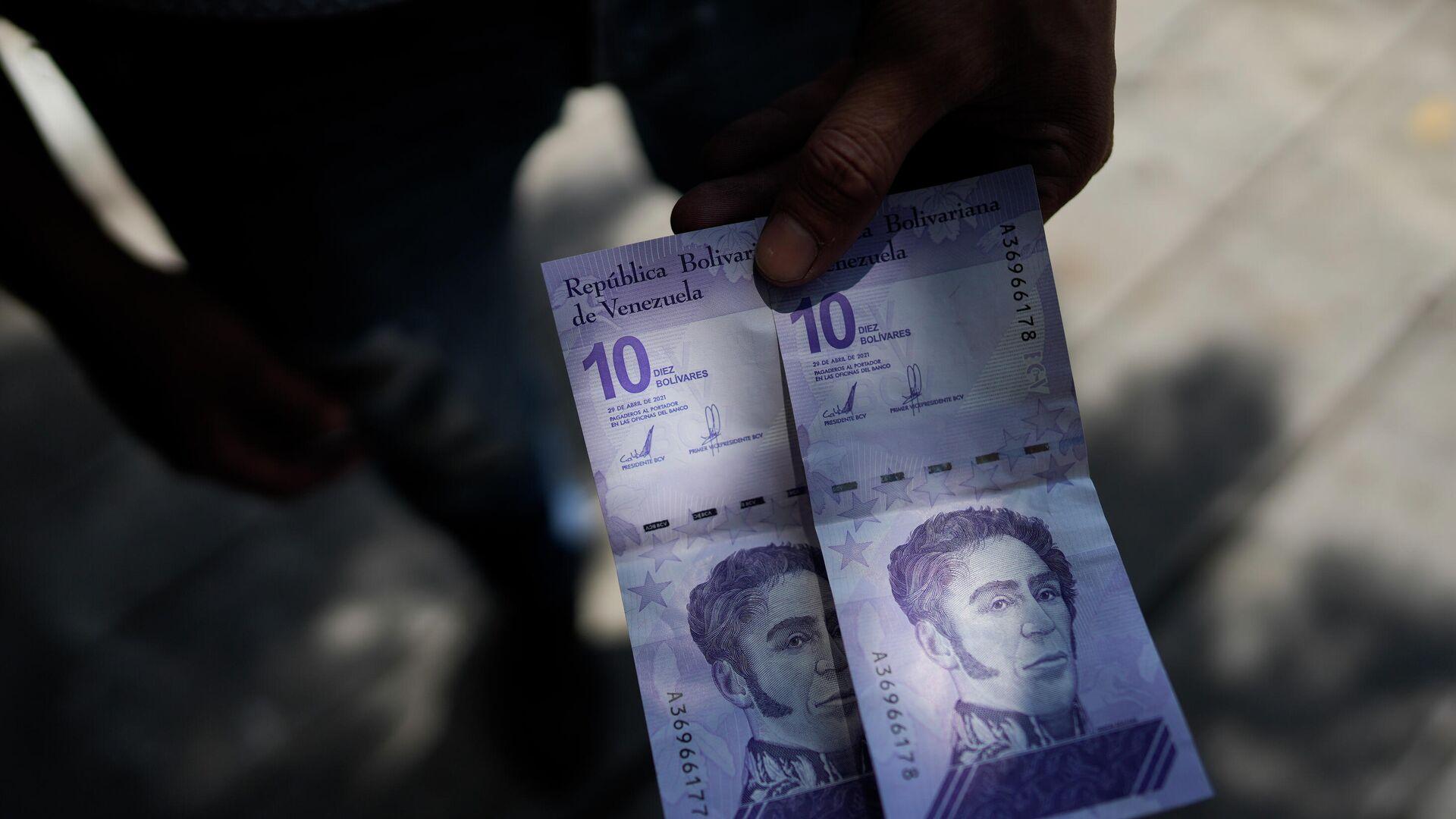 Billetes de 10 bolívares venezolanos - Sputnik Mundo, 1920, 10.10.2021