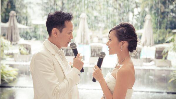 Las autoridades chinas prohíben interpretar el himno nacional en bodas y funerales - Sputnik Mundo