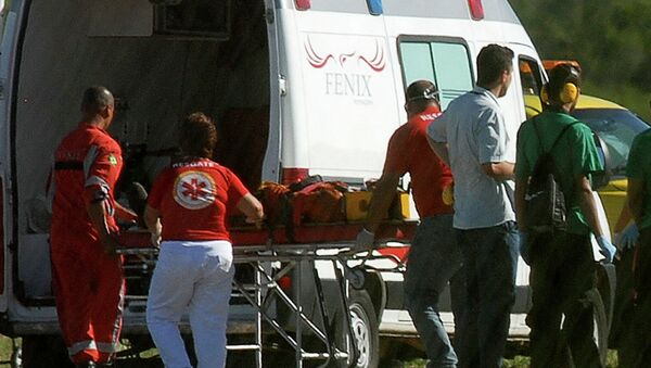 A person rescued from the Cidade de Sao Mateus, a floating oil production, storage and offloading ship (FPSO), is wheeled to an ambulance by paramedics at the Eurico de Aguiar Salles airport in Vitoria - Sputnik Mundo