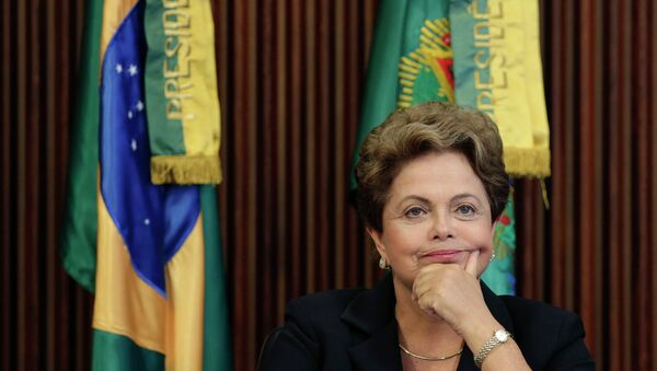 Brazil's President Dilma Rousseff reacts during the sixth meeting of the National Council for Industrial Development (CNDI) at the Planalto Palace in Brasilia February 9, 2015 - Sputnik Mundo