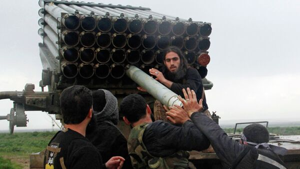 Rebel fighters of the Al-Furqan brigade prepare Grad rockets to be launched towards forces loyal to Syria's President Bashar Al-Assad stationed in Salhab village, from the orchards of the west of al-Zukat village - Sputnik Mundo