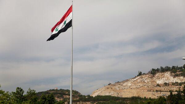 Syrian flag over the capital, Damascus, Syria - Sputnik Mundo