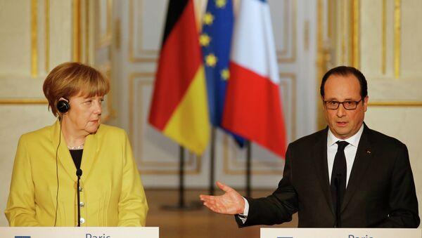Ángela Merkel y François Hollande - Sputnik Mundo