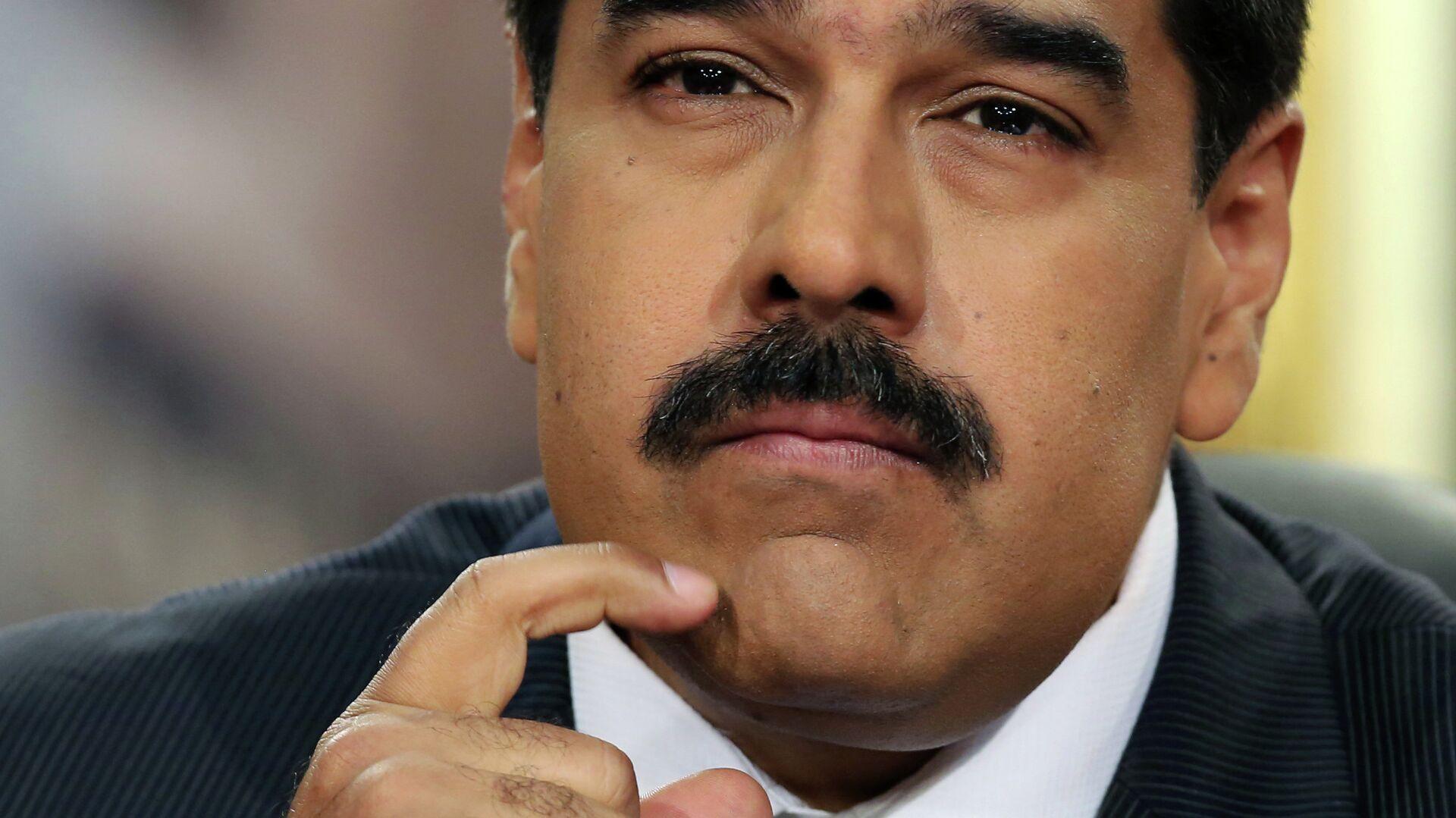 Venezuela's President Nicolas Maduro pauses during his speech at a press conference at Miraflores Presidential Palace in Caracas, Venezuela, Tuesday, Dec. 30, 2014 - Sputnik Mundo, 1920, 23.09.2021