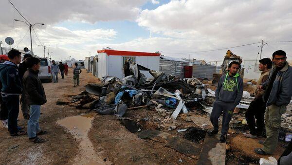 Refugiados sirios en el campo de refugiados de Al-Zaatari en la ciudad jordana de Mafraq - Sputnik Mundo