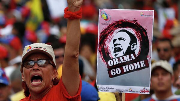 A supporter of Venezuela's President Nicolas Maduro rally against imperialism, in Caracas March 15, 2015 - Sputnik Mundo