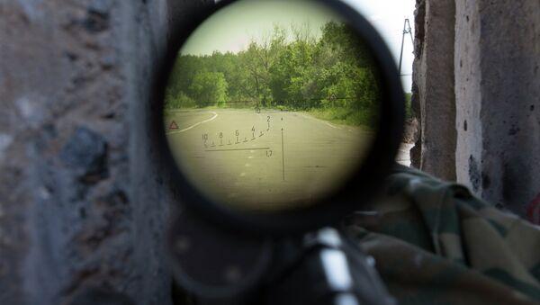 Vista a través de rifle de francotirador - Sputnik Mundo