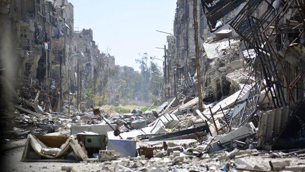 Vista general del campo de refugiados palestinos de Yarmuk en Damasco. 6 de abril de 2015 - Sputnik Mundo