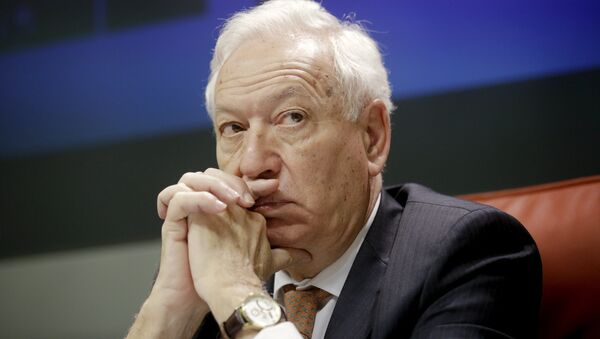 Spanish Foreign Minister Jose Manuel Garcia-Margallo answers a question during a joint news conference with his Iranian counterpart Mohammad Javad Zarif (unseen) at the foreign ministry in Madrid, April 14, 2015 - Sputnik Mundo