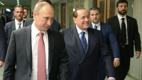 Russian President Vladimir Putin, left, and former Italian prime minister Silvio Berlusconi at their meeting in Rome, June 10, 2015 - Sputnik Mundo