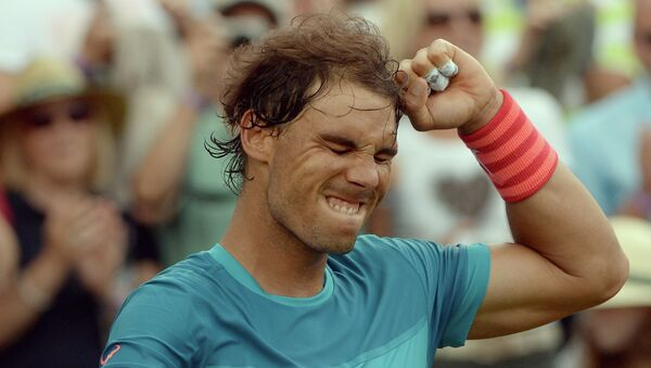 El español Rafael Nadal celebra luego de vencer al francés, Gael Monfils, en la semifinal del torneo de Stuttgart, Alemania, el sábado 13 de junio de 2015 - Sputnik Mundo